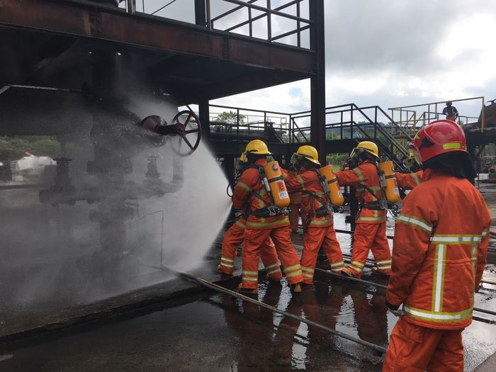 The fighter. Fire Firebrigade Emergancy Drill Team  Rescue Working Training Outdoors Fighters Nautical Vessel Men Adults Only Full Length Adult People Only Men Teamwork Working Sports Clothing Day Sports Team Young Adult