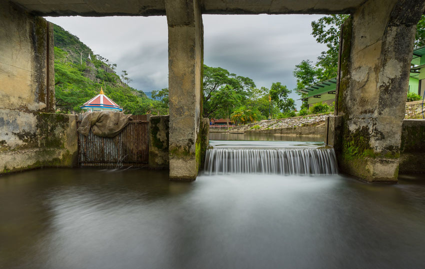 Water flowing from the dam, catchment area in countryside Thailand Architecture Catchment Area Flowing Stream Flowing Water Splashing Water Barrier Cascade Countryside Dam Dam Construction Dam Lake Day Flowing Water Motion Nature No People Outdoors Riverbank Splash Splashing Water Water Flow Water Flowing Water Splash Waterfall