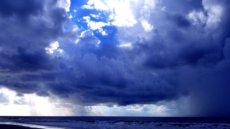 Storm Cloud Ocean Blue Backgrounds Weather Stormy Weather Storm Rain On The Beach Thunderstorm Water Sea Storm Cloud Power In Nature Storm Sky Dramatic Sky Cloudscape Meteorology Extreme Weather