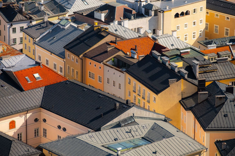 The Salzburg city view - colorful buildings. Architecture Building Exterior Built Structure Building Roof Residential District City High Angle View House Crowd Town Day Crowded Nature Roof Tile Outdoors City Life Apartment Community TOWNSCAPE Salzburg Austria Color Streetphotography Aerial View