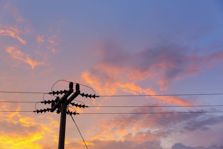 Sky Cloud - Sky Sunset Cable Low Angle View Technology Electricity  Connection Power Line  Orange Color No People Power Supply Nature Fuel And Power Generation Electricity Pylon Outdoors Beauty In Nature Silhouette Scenics - Nature Pole Electrical Equipment Telephone Line