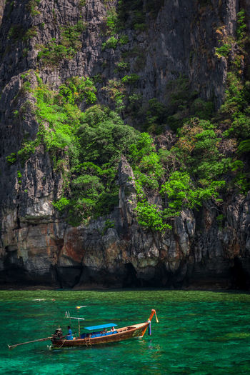 The calender shot Beauty In Nature Boat Boat By The Mountain Boat By The Ocean Cliff Day Formation Greenery Land Mode Of Transportation Mountain Nature Nautical Vessel Outdoors Real People Rock Rock - Object Rock Formation Scenics - Nature Sea Solid Transportation Travel Water Waterfront Go Higher