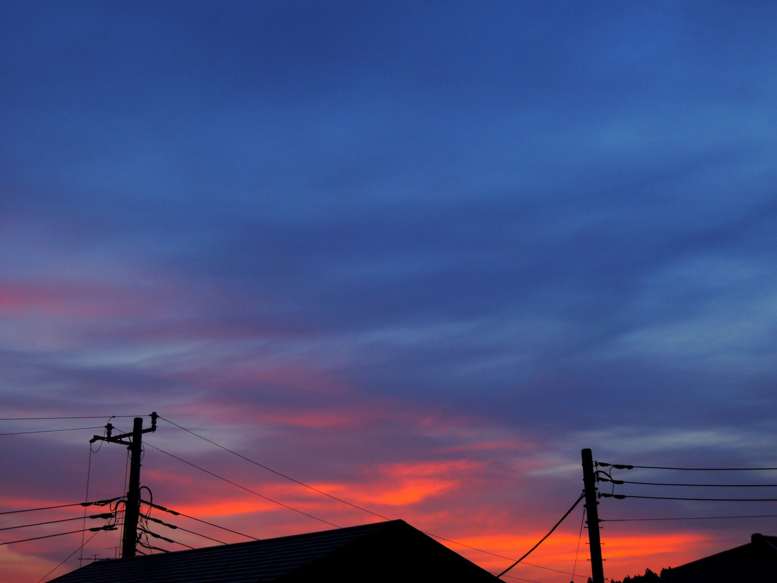 sunset, low angle view, silhouette, electricity pylon, sky, power line, power supply, fuel and power generation, electricity, technology, connection, orange color, cloud - sky, cable, built structure, dusk, dramatic sky, cloud, cloudy, outdoors