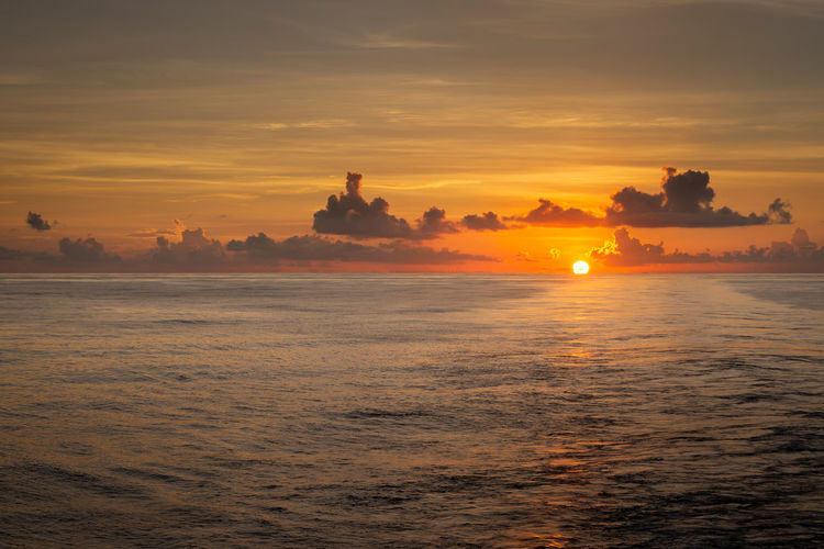 When the setting sun kiss the horizon Sunset Sky Orange Color Cloud - Sky Beauty In Nature Water Sun Sea Nature Tranquility Sink Horizon Dusk