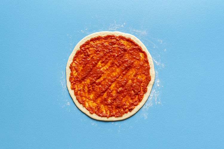 Directly above shot of pizza against blue background