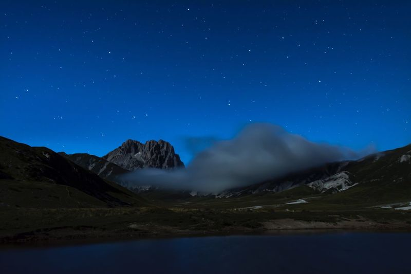 Night Mountain Scenics Nature Blue Beauty In Nature Star - Space Mountain Range Idyllic Landscape Sky Tranquil Scene Snow Illuminated No People Outdoors Astronomy