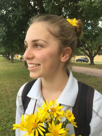 Plant Flower One Person Smiling Young Adult Real People Young Women Headshot Front View Lifestyles Beautiful Woman Hairstyle Outdoors Hair Day Women Flower Head Yellow Nature
