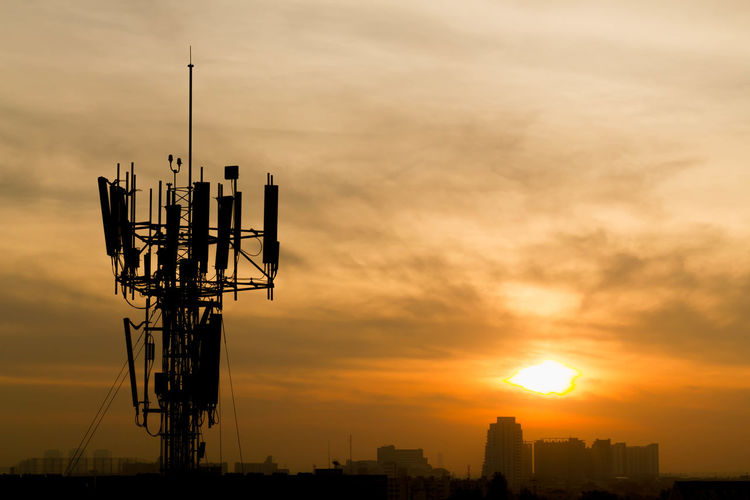 Mobile phone Telecommunication Radio antenna Tower with sunset sky, silhouette Aerial Antenna Broadcast Broadcasting Business Cable Cell Cellular Central Channel Communication Connection Electricity  Engineering Equipment Frame Global Industry Information LINE Microwave Mobile Network PhonePhotography Radio