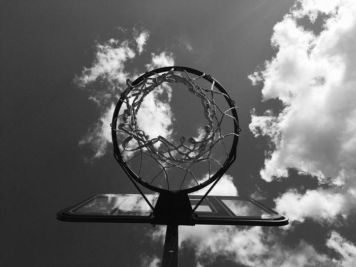 Directly Below Shot Of Basketball Hoop Against Sky
