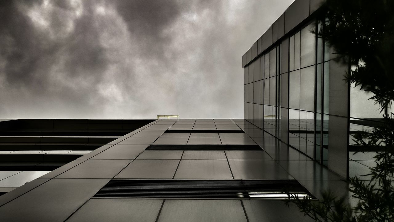 building exterior, architecture, built structure, modern, city, growth, day, outdoors, low angle view, sky, skyscraper, no people, window, city life, corporate business, tree