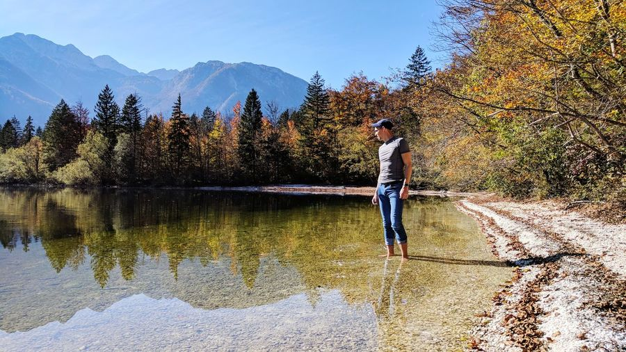 Only Men Men One Man Only One Person Adult Nature Tree Adults Only Outdoors People Day Water Standing Mountain Beauty In Nature Real People Sky Young Adult Autumn Colors Landscape Slovenia Bohinj Lake Standing In Lake Autumn