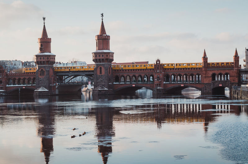 Oberbaumbridge in Berlin during the winter season Architecture Berlin Bridge City Cityscape Connection Day Friedrichshain Ice On The Water Kreuzberg No People Oberbaumbridge Oberbaumbrücke Outdoors Reflection River Sky Spree River Berlin Travel Travel Destinations Water Waterfront Winter Winterscapes Wintertime