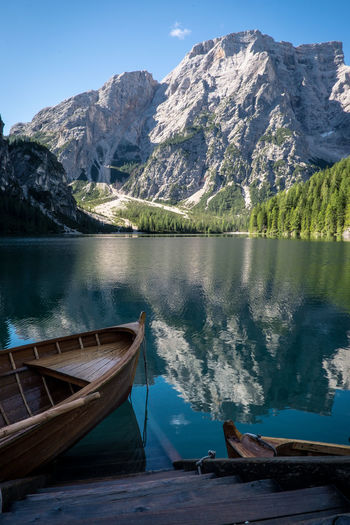 Rowboat Moored At Lake Braies By Rocky Mountains