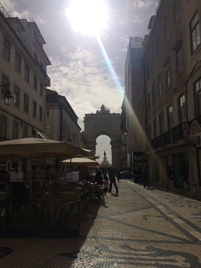 Urban street life in Lisbon, Portugal Arch Architecture Building Building Exterior City City Life History Light Outdoors Residential District Street Urban