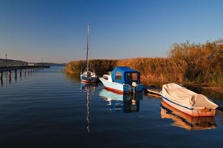 Boats Moored In Calm Blue Sea