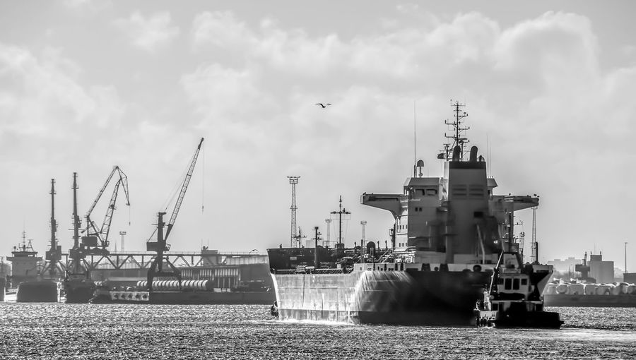 Trawler Transportation Logistics Business Harbour Harbor Sky Architecture Water Nautical Vessel Transportation Built Structure Cloud - Sky Industry Building Exterior Mode Of Transportation Machinery No People Sea Cruise Ship Ship Day Outdoors Travel