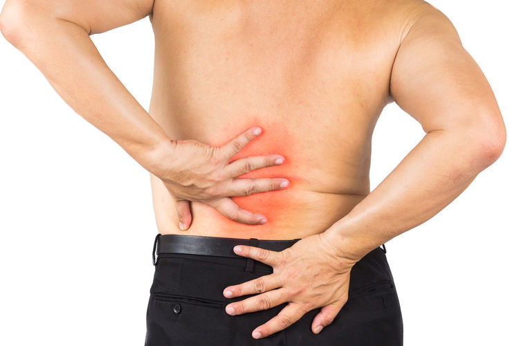 Asian man with intense pain on lower back Asian  Adult Back Pain Hand Inflammation Malaysian Midsection One Person Pain Red Color Skin Standing Studio Shot White Background