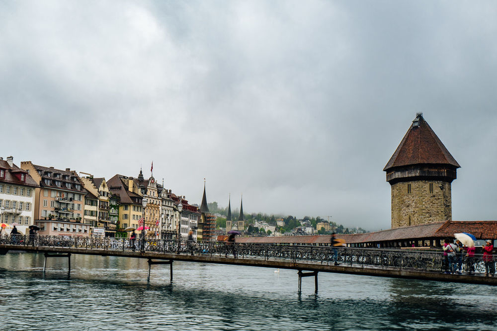 Architecture Bridge - Man Made Structure Building Exterior Built Structure Canal Capital Cities  Chappel Bridge City City Life Cloud Cloud - Sky Cloudy Day Kappelbrücke Lifestyles Lucerne Outdoors Rain Rippled River Sky Tourism Travel Destinations Water Waterfront