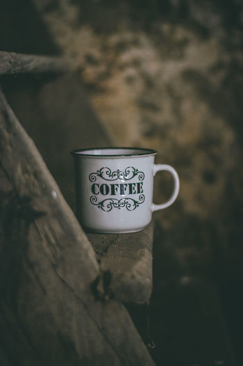 Close-up of coffee cup on wood