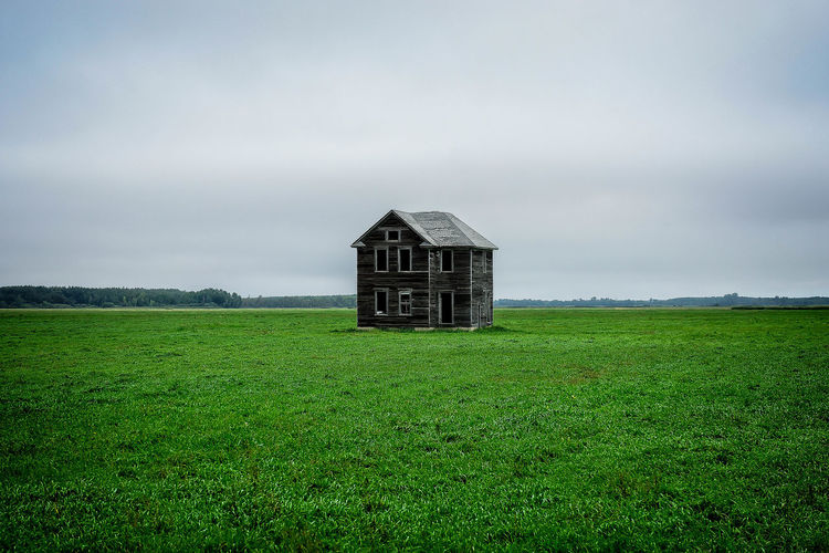 Abandoned Deceptively Simple House Isolated Field Green Grass Empty