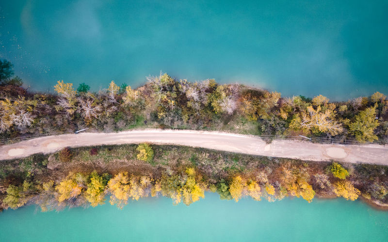 Aerial view of lakes devided by road and trees