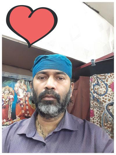 Portrait of man making heart shape
