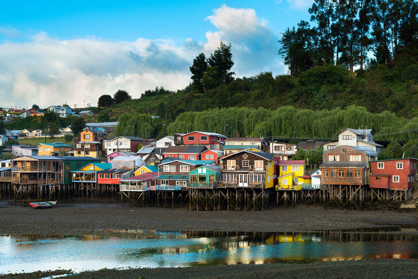 Traditional stilts houses known as palafitos in Castro, Chiloe island, Chile Chile Chilean  Chiloe Island Chiloé, Chile Isla De Chiloe Latin America Palafitos Stilts Architecture Attraction Castro House Landscape Latin American Nature No People Outdoors Pile Dwelling Pillars River Scenics Stilts House Traditional Water Waterfront