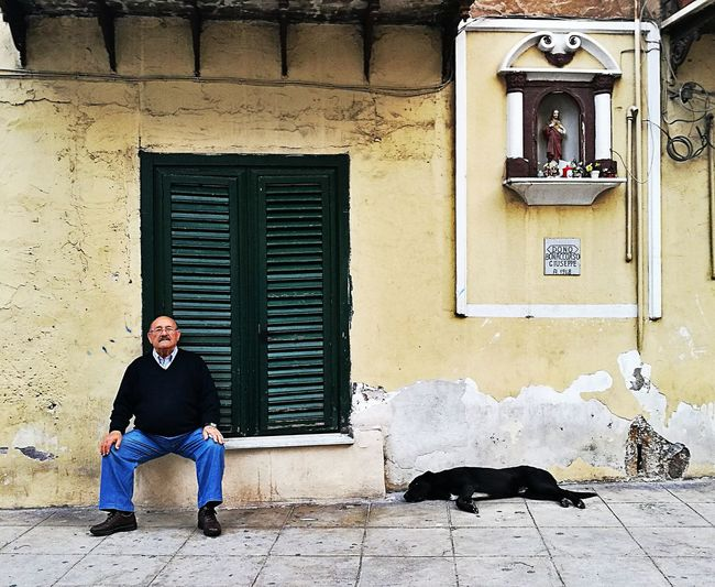 Sicilia Sicily Love Old Man Ballaro' Palermo South Italy Italia History City Full Length Men Sitting Architecture Building Exterior Built Structure Cat Ghetto Pets Dog Focus On The Story