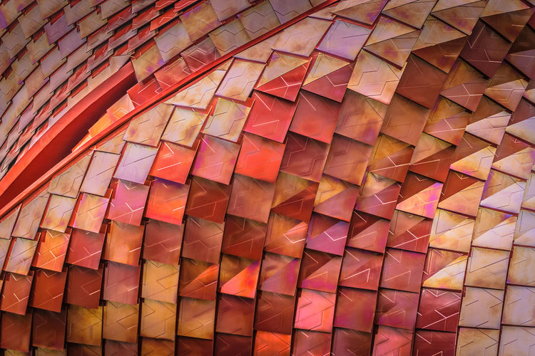 Dragonskin. Shimmery, metal structure. Abstract Arrangement Design Dragonskin Geometry Industrial Metal Modern Order Ornate Outside Pattern Red Shimmery Structure Tiles Wall Wallpaper