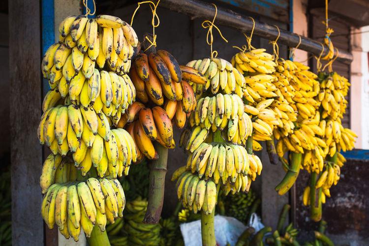 Close-up of fruits hanging at market stall