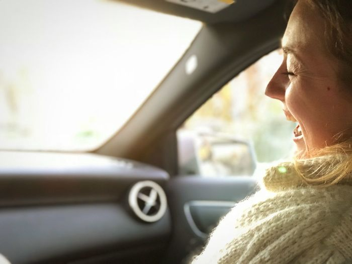 Close-up of woman in car