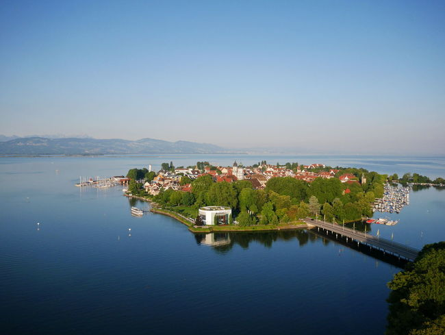 aerial view of island Lindau in the Lake Constance (Bodensee) Insel Lake Constance Linda Lindau Lindau Bodensee Lindau Island Architecture Beauty In Nature Building Exterior Built Structure Clear Sky Day High Angle View Lake Lindau Insel Mountain Nature No People Outdoors Reflection Scenics Sky Tree Water Waterfront