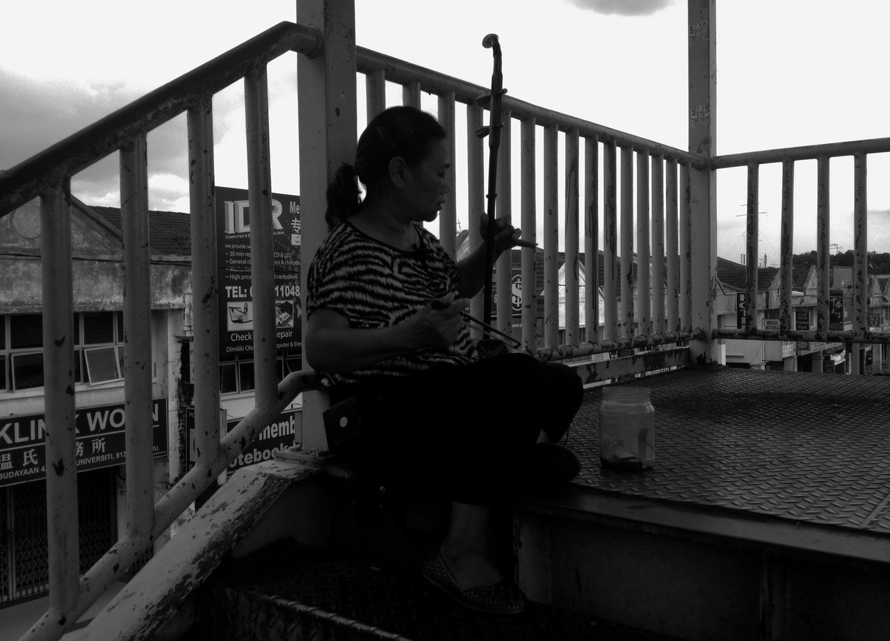 BOY PLAYING WITH RAILING