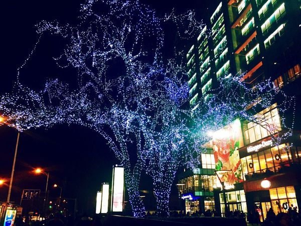 night Night Illuminated Building Exterior City Architecture Celebration Built Structure Celebration Event Christmas Outdoors City Life Low Angle View Christmas Decoration Street Light Nightlife Neon Crowd Sky People