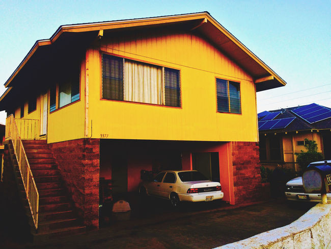 Architecture Building Building Exterior Built Structure Car City Day Garage House Land Vehicle Motor Vehicle No People Outdoors Residential District Sky Street Transportation Window Yellow
