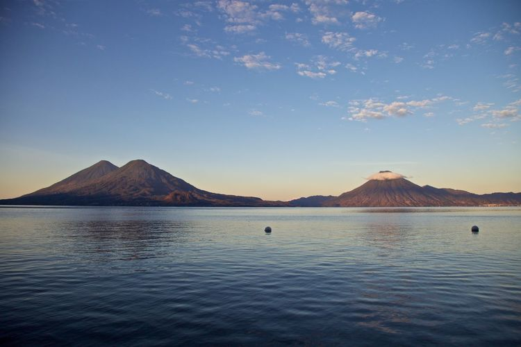 Con sombrero Sunrise_sunsets_aroundworld Lake View Water Mountain Scenics - Nature Beauty In Nature Sky Waterfront Tranquil Scene Tranquility No People Nature Idyllic Sea Blue Non-urban Scene Volcano Day Land Travel Destinations Outdoors Mountain Peak