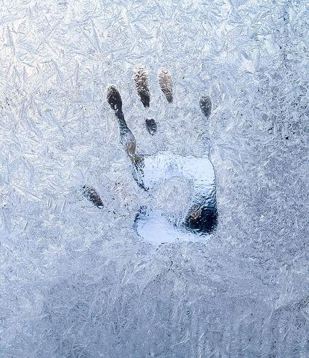Full frame shot of frozen water on land