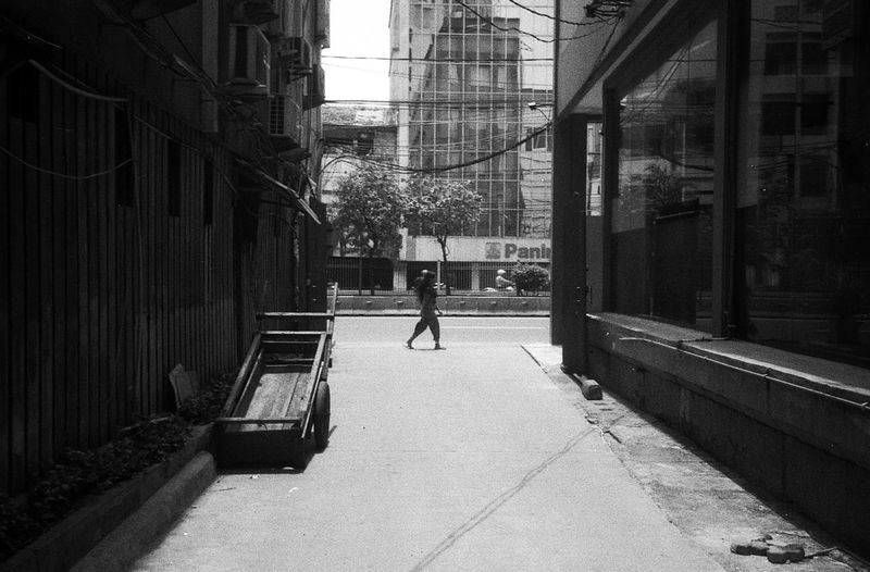 The Street Photographer - 2017 EyeEm Awards One Person City Outdoors LifestylesPeople Streetphotography Filmphotography Daily Life 35mm Daily Activities Jakarta INDONESIA