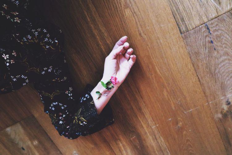 High angle view of woman lying on hardwood floor