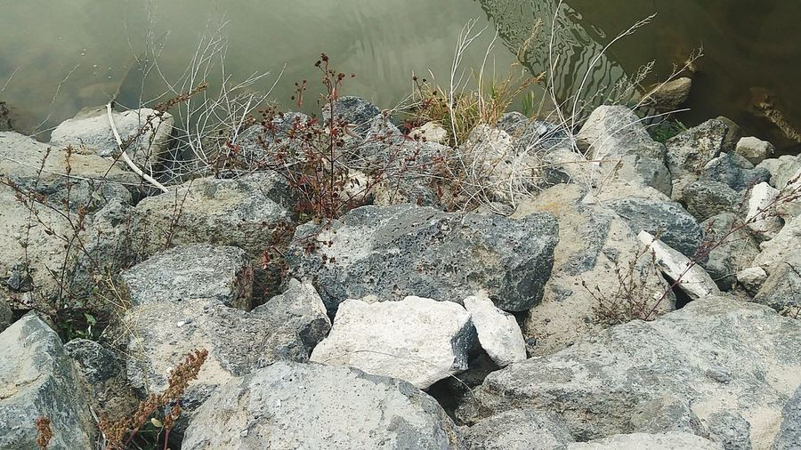 Downward Day Nature No People Outdoors Backgrounds Close-up Rocks And Water Rocks In Water Waterfront Water_collection Wall - Building Feature Wall Of Rocks Nature_collection Sunlight And Shadow
