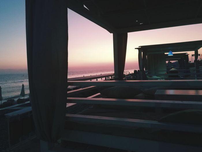 View of sea through car window