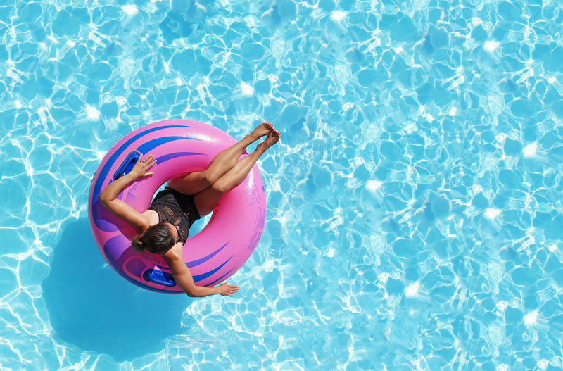 Relaxation Therapy. Travel Destinations Travel Vacations Pool Floatie Innertube Relaxing Relaxation Relax Calm Blue Water Pink Color Summer Summertime Recreation  Vacation Poolside Water Swimming Pool Full Length Summer High Angle View Inflatable Ring Float Water Park Pool Party Floating Pool Raft Inflatable  Floating On Water International Women's Day 2019