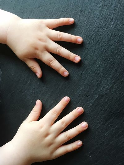 Cropped hands of child on table