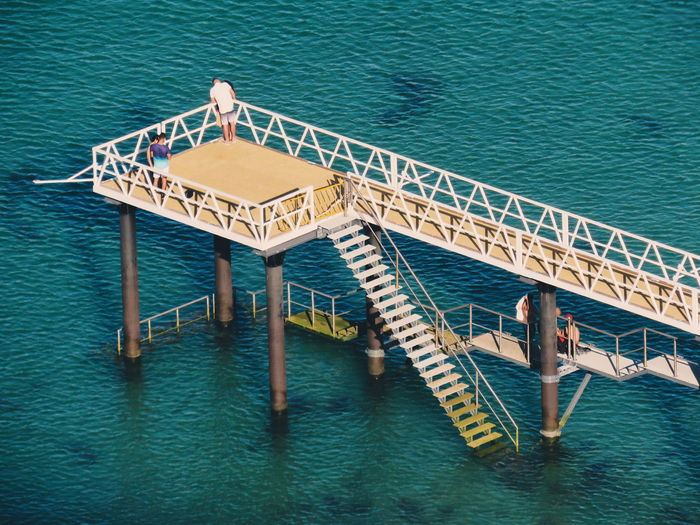 Water Sea Offshore Platform Blue High Angle View Pier Architecture Built Structure Calm Stairs Horizon Over Water Lifeguard Hut Spiral Stairs Lifeguard  Shore Steps And Staircases Lakeside Diving Platform Sandy Beach Ocean Rippled Stilt Hand Rail