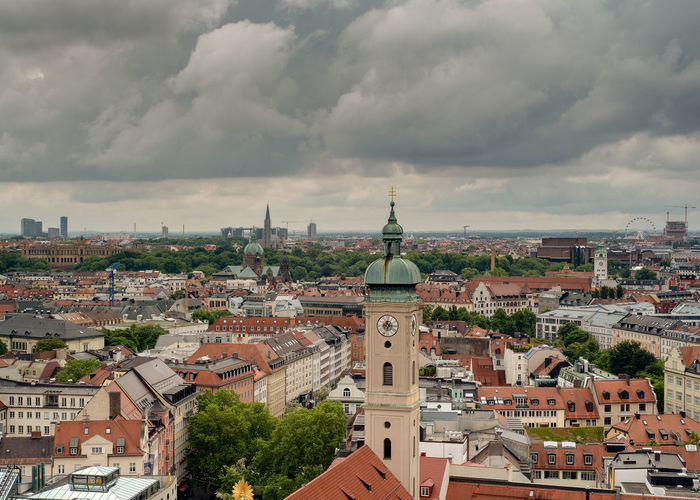 Munich, Bavaria, Germany - May 29, 2019. General aerial view of Munich from a tower, featuring the Church of St. Peter (Alter Peter) on a partly cloudy day Aerial Architecture Bavaria Bavarian Building Cathedral Church Cityscape Cloudy Europe European  Church St. Peter Alter Peter Germany Hall Historic Holiday Marienplatz München Munich Old Panorama Panoramic Red Religion Roof Scenic Shape Sky Summer Symbol Tourism Tower Travel Urban View Labeled Editorial  Downtown Ancient Spring Day Building Exterior Built Structure Residential District TOWNSCAPE No People Cloud - Sky