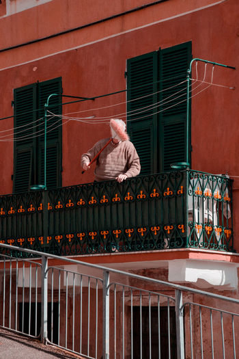 SIGNORE Old Man Portrait Of An Old Man Elderly Man Italy Cinque Terre Portrait Portrait Photography Architecture And People Exterior Windows Architecture_collection Clean Cleaning Broom Surreal Surrealism Magritte City Red Architecture Building Exterior Built Structure