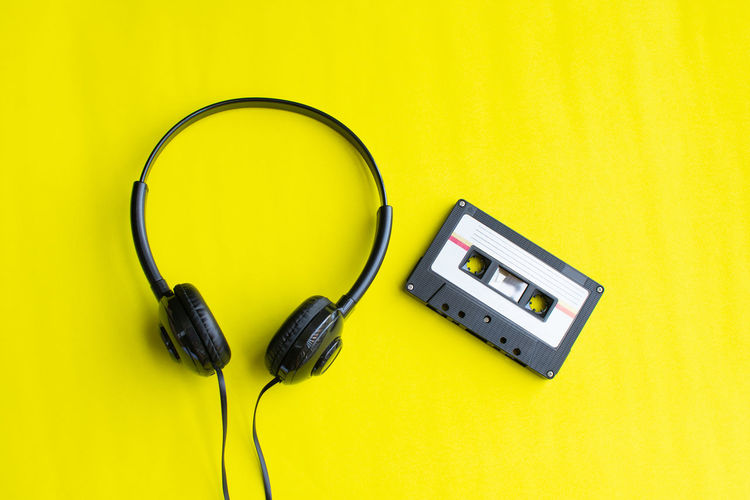 Tape Cassette Old Vintage Retro Technology Yellow Cable Colored Background Connection Headphones Listening Studio Shot Indoors  Yellow Background Electricity  Still Life No People Electric Plug Music Single Object Communication Close-up Black Color Equipment Power Supply