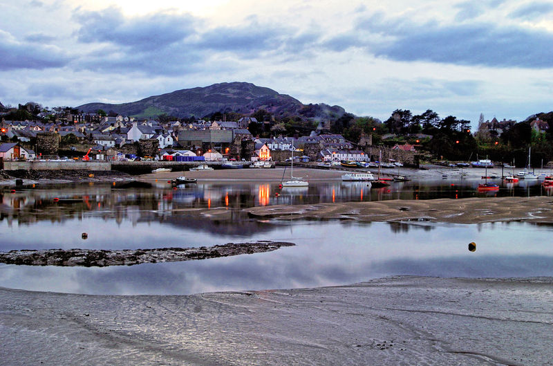 Early Evening at Conwy Harbour , Wales Conwy Harbour Architecture Beauty In Nature Building Building Exterior Built Structure City Cityscape Cloud - Sky Day House Mountain Nature No People Outdoors Reflection Residential District Scenics - Nature Sky Town Tranquility Water Waterfront