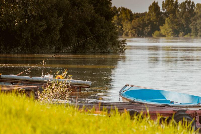 Boats moored at danube riverbank