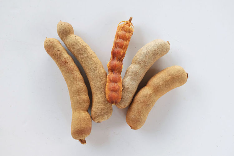 High angle view of cookies against white background